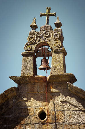 church bells: Medieval christian campanile built with granite with bronze bells