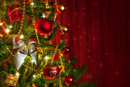 Detail of a Christmas tree next to red window curtains with copy space Stock Photo - 23909816