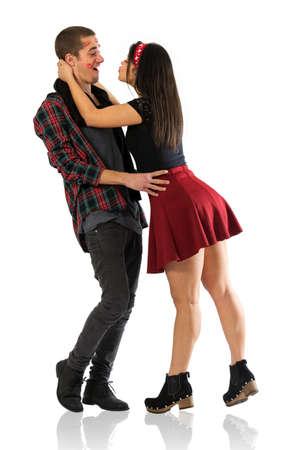 Insatiable pretty brunette girl stealing kisses from her boyfriend
