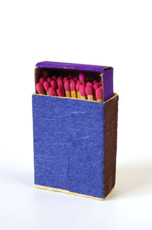 Blue matchbox with new matches inside photo