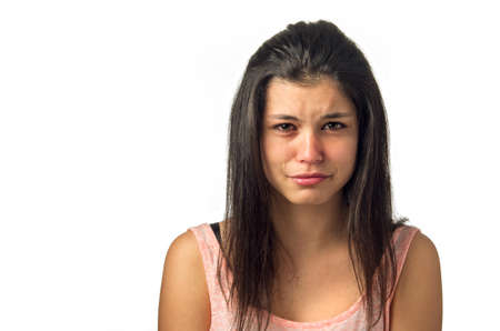 Brunette teenager girl crying with sadness expression  Stock Photo