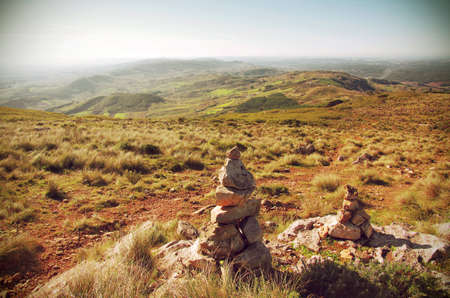high desert: Mountain hiking trail with stone piles or cairns marking the way