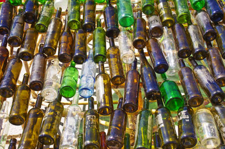 Close-up of colorful but dirty empty wine bottles  photo
