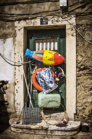 trashy: Messy home entrance with many colorful and trashy objecs. Editorial
