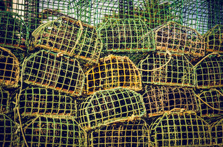 background of piled group of fishing cage traps photo