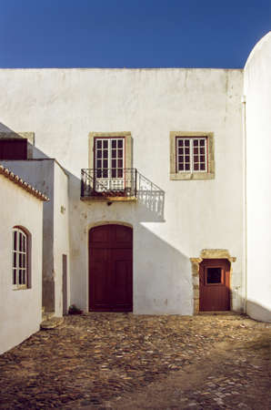 Facade of old white rural house in Portugal photo