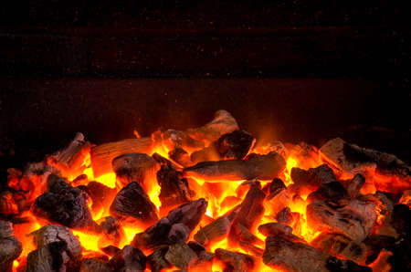 barbecue fire: Photo of hot sparking live-coals burning in a barbecue