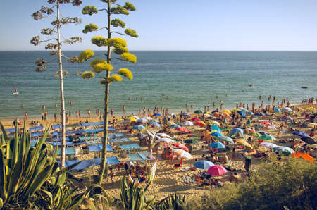 vacationers: ALGARVE, PORTUGAL - JULY 22nd 2014: Vacationers in Pera Beach, in Algarve on July 22nd, 2014. Algarve is a major destination for beach and warm weather for mostly British an German tourists, with nearly 500.000 accommodations.  Editorial