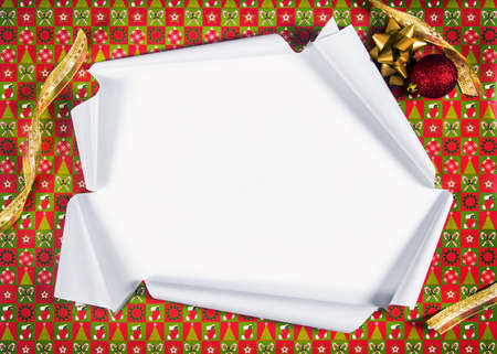 Unwrapping gifts by ripping the paper and revealing the content photo