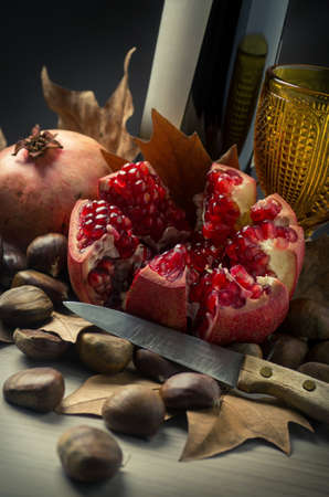 cheff: Autumn Fall still-life with red wine, pomegranate and chestnuts