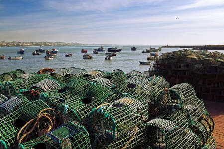 lobster pots: Fishing traps in a port of Cascais, Portugal Stock Photo