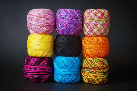 coils: A pile of colorful yarn coils over grey background Stock Photo
