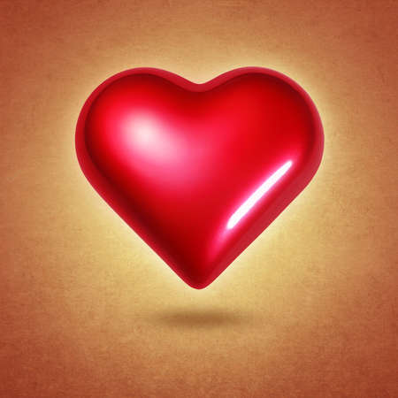 Big red shining heart hovering over textured yellow background photo