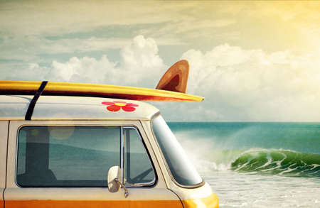 hippies: Idyllic surfing way of life with a van and long board near the sea