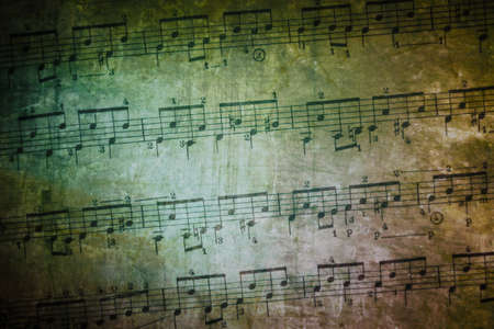 old sheet music: background of weathered and textured old music sheet