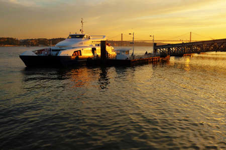 ferryboat: Ferryboat docked ina pier in Lisbon at Sunset Stock Photo