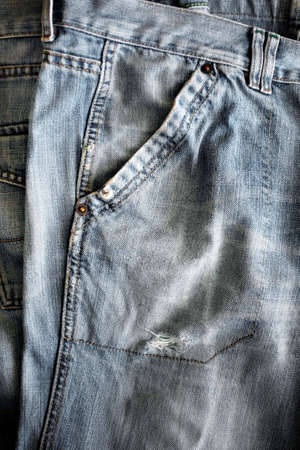 washed out: Closeup detail of a washed out blue jeans pocket