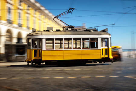 electric tram: Lisbon traditional old electric tram speeding in Comecio Square Editorial