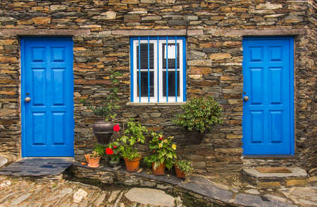 wall light: Detail of door in old stone house in a remote portuguese rural village Stock Photo