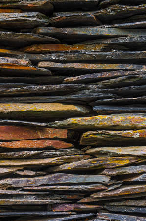 schist: Background detail of rural house with piled schist stone blades