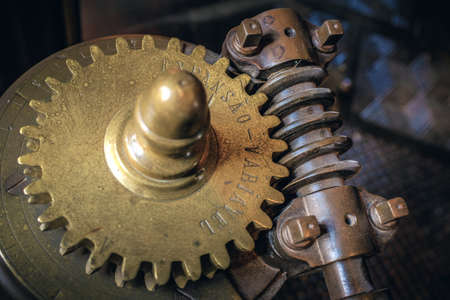 interlock: Closeup on mechanical gear wheels and old industrial machine parts.