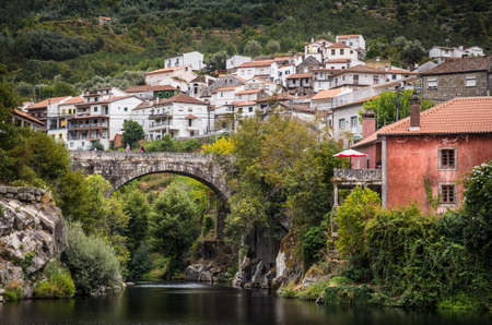 portugal: Remote rural portuguese town Avo with a river and old roman bridge