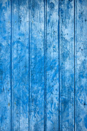 rusty: Detail of an old wooden door with scratched blue paint