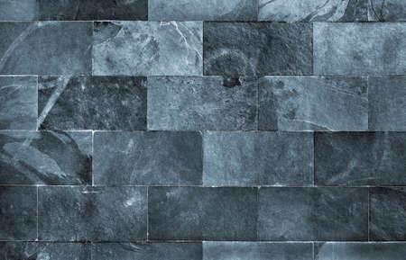 schist: Fraction of a dark schist wall with brick texture
