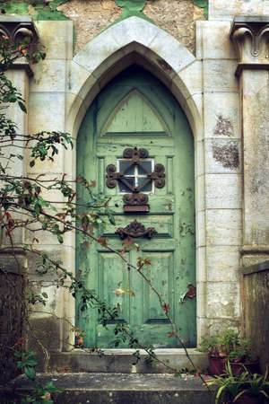 green door: Old gothic door in romantic style with peeling green paint