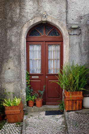 european: Typical old door in a alley of portuguese town of Sintra
