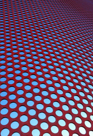 perforated: Perforated red panel with little round holes Stock Photo