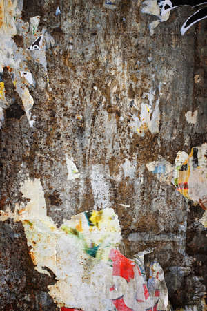 ravaged: Background of messy wall surface with remains old ripped posters Stock Photo
