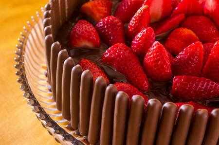 irresistible: Irresistible frash chocolate and strawberry cake over yellow background