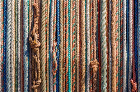 aligned: Background of aligned colorful old fishing ropes under sunlight Stock Photo