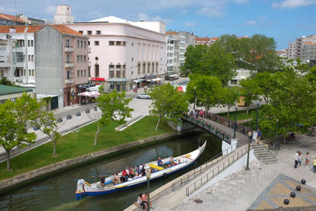 Aveiro, Portugal - 17 June 2016. Typical Moliceiro boat in the canals of the city of Aveiro in Portugal
