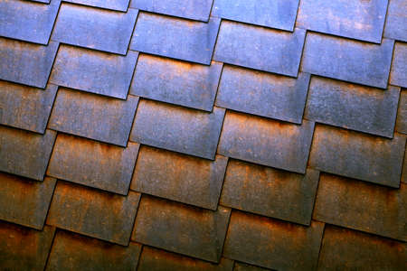 Background of modern pattern made with rusty old retangular iron plaques