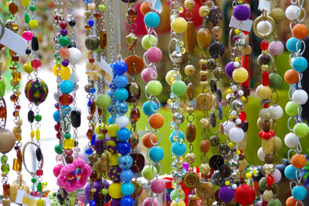 sale shop: Colorful bijouterie and necklaces with beads hanging for sale in a shop