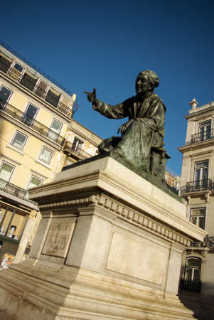 Bronze statue of poet Antonio Ribeiro in Chiado square in Lisbon, Portugal Stock Photo