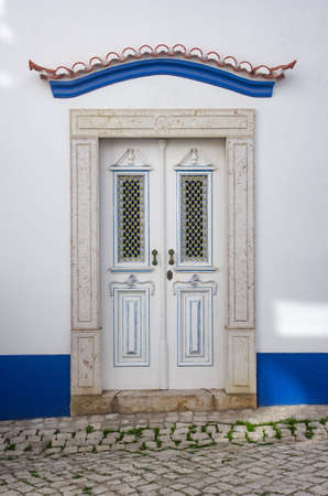 Typical recovered door in a building in the village of Ericeira, Portugal