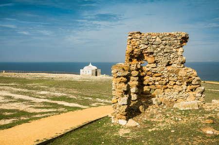 Cape Espichel chapel and ruin of old stone wall