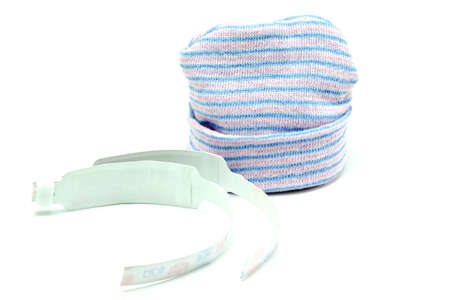wristbands: Baby Beanie and Hospital Wristbands Isolated on White Stock Photo