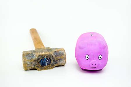 deceleration: Safe-shaped pork with sledgehammer beside looking scared