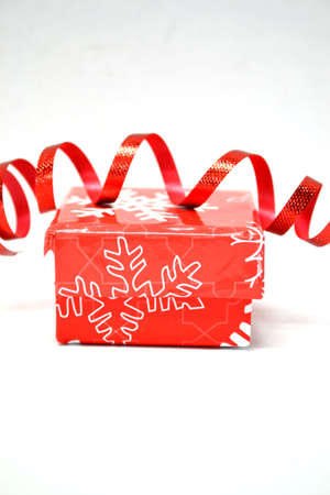 red christmas gift box with red ribbon isolated on white Stock Photo