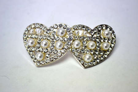 pearl and rhinestone heart hairclip isolated on white background close up