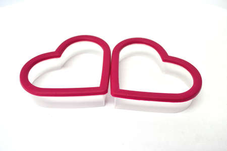 two heart cookie cutters isolated on white background Stock Photo