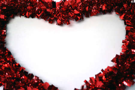 white heart bordered with red garland close up Stock Photo