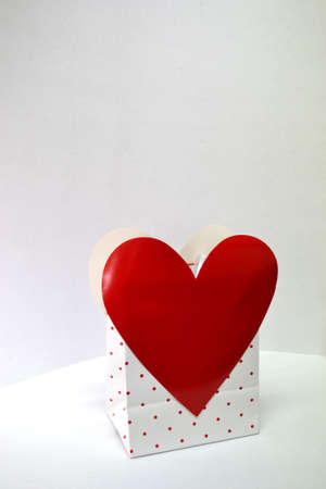 red and white heart gift bag isolated on white background