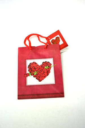 flat red heart gift bag isolated on white background