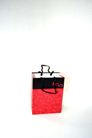 red and black gift bag isolated on white background