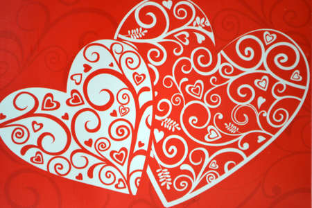 two hearts isolated on red background close up